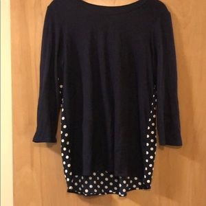 Simple navy top with fun polka dot back